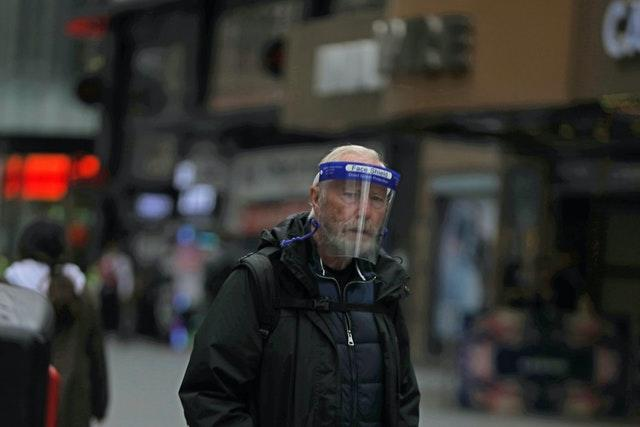 A man wearing a face shield