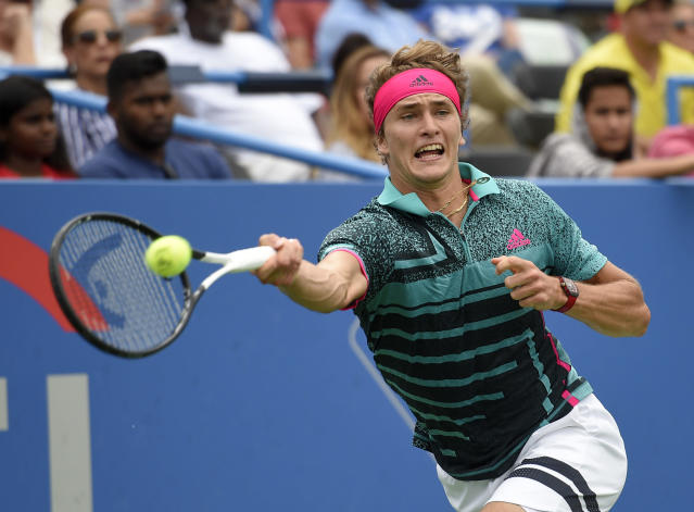 Alexander Zverev, of Germany, returns the ball against Kei Nishikori, of Japan, during the Citi Open tennis tournament, Friday, Aug. 3, 2018, in Washington. (AP Photo/Nick Wass)