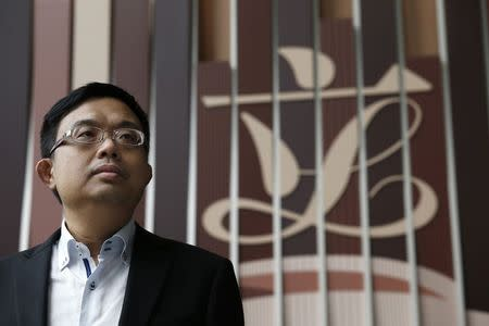 Pro-democracy lawmaker James To poses in front of the Legislative Council logo inside the council building in Hong Kong December 4, 2014. Picture taken December 4. REUTERS/Bobby Yip