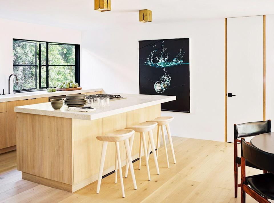 "<p>As seen in this Malibu kitchen by Romanek Design Studio, a serving window makes spaces feel more open and air but they also make life easier. Even better, they typically connect the kitchen to a backyard or deck space and promote <a href=""https://www.housebeautiful.com/room-decorating/outdoor-ideas/g853/outdoor-room-design-ideas/"" rel=""nofollow noopener"" target=""_blank"" data-ylk=""slk:indoor/outdoor"" class=""link rapid-noclick-resp"">indoor/outdoor</a> living, so they're especially popular if you live somewhere warm and love to host al fresco dinners. </p>"