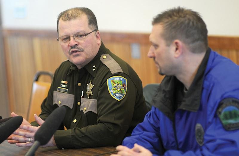Grays Harbor Undersheriff Rick Scott, left, and Montesano Police Chief Brett Vance brief the media on a shooting at the county courthouse in Montesano, Wash. Friday March 9, 2012 (AP Photo/The Daily World, Jacob Jones).