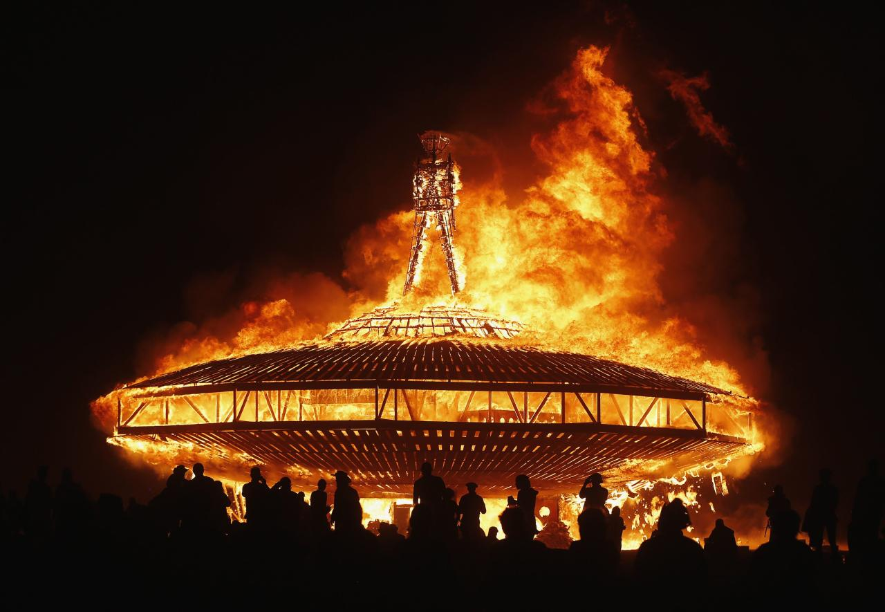 The Man burns during the Burning Man 2013 arts and music festival in the Black Rock Desert of Nevada, August 31, 2013. The federal government issued a permit for 68,000 people from all over the world to gather at the sold out festival, which is celebrating its 27th year, to spend a week in the remote desert cut off from much of the outside world to experience art, music and the unique community that develops. REUTERS/Jim Urquhart (UNITED STATES - Tags: SOCIETY TPX IMAGES OF THE DAY) FOR USE WITH BURNING MAN RELATED REPORTING ONLY. FOR EDITORIAL USE ONLY. NOT FOR SALE FOR MARKETING OR ADVERTISING CAMPAIGNS. NO THIRD PARTY SALES. NOT FOR USE BY REUTERS THIRD PARTY DISTRIBUTORS