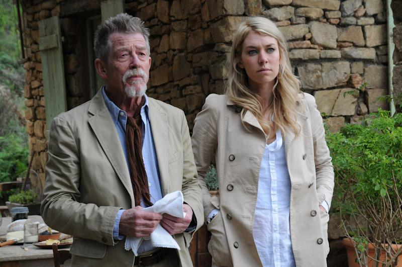 """This photo released by The CW shows John Hurt, left, as Audric Baillard and Vanessa Kirby as Alice Tanner, in a scene from """"Labyrinth."""" The CW network said it has acquired the miniseries about the search for the Holy Grail. The cast of the four-hour project, """"Labyrinth,"""" includes former """"Downton Abbey"""" star Jessica Brown-Findlay, Kirby, Sebastian Stan and Hurt. (AP Photo/The CW)"""