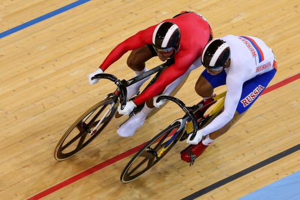 LONDON, ENGLAND - AUGUST 05:  Njisane Nicholas Phillip of Trinidad and Tobago (L) wins against Denis Dmitriev of Russia during the Men's Sprint Track Cycling Quarterfinals on Day 9 of the London 2012 Olympic Games at Velodrome on August 5, 2012 in London, England.  (Photo by Cameron Spencer/Getty Images)