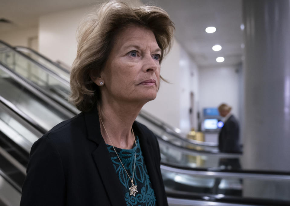FILE - In this Jan. 8, 2020, file photo Sen. Lisa Murkowski, R-Alaska, heads to a briefing on Capitol Hill in Washington. An Alaska man faces federal charges after authorities allege he threatened to hire an assassin to kill Murkowski, according to court documents unsealed Wed., Oct. 6, 2021. (AP Photo/J. Scott Applewhite,File)