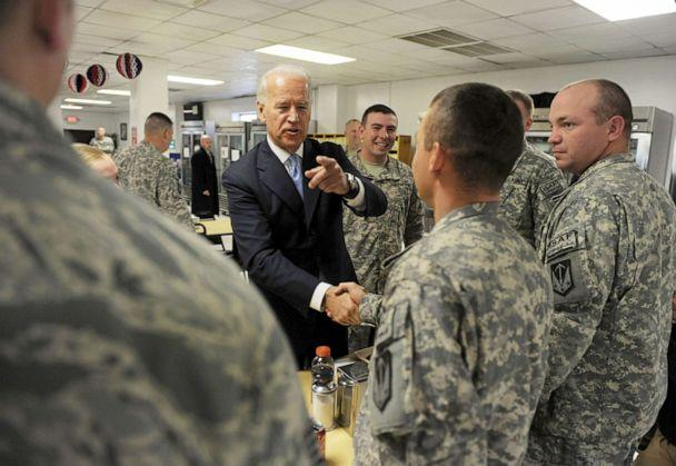 PHOTO: US Vice President Joe Biden shakes hands with US soldiers at Bagram airbase, some 50 km north of Kabul, Jan. 12, 2011. (Shah Marai/AFP via Getty Images, FILE)