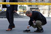 <p>A police detective investigates an incident where a van struck multiple people at a major intersection northern Toronto, Ontario, Canada, April 23, 2018. REUTERS/Chris Donovan </p>