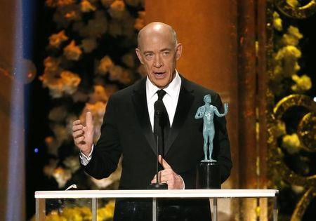 """J.K. Simmons accepts the award for Outstanding Performance by a Male Actor in a Supporting Role for the film """"Whiplash"""" at the 21st annual Screen Actors Guild Awards in Los Angeles, California January 25, 2015. REUTERS/Mario Anzuoni"""