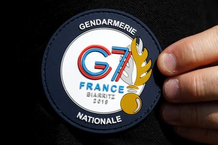 FILE PHOTO: A G7 Summit patch is seen on a French Gendarme's uniform as he patrols at a toll station in Anglet ahead of the G7 Summit in the French coastal resort of Biarritz