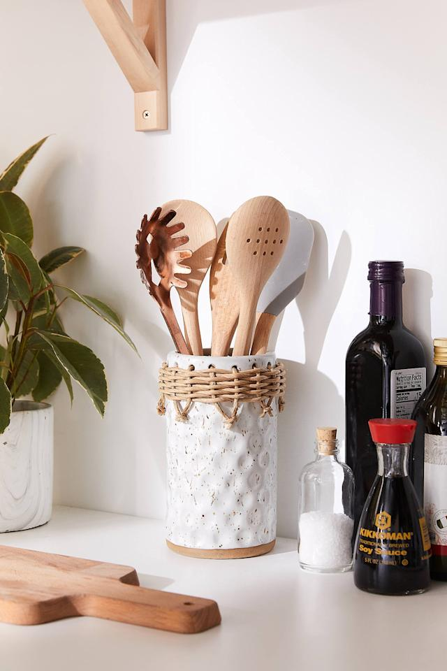 """<p>The <a href=""""https://www.popsugar.com/buy/Neya-Utensil-Holder-426675?p_name=Neya%20Utensil%20Holder&retailer=urbanoutfitters.com&pid=426675&price=29&evar1=savvy%3Aus&evar9=36292182&evar98=https%3A%2F%2Fwww.popsugar.com%2Fphoto-gallery%2F36292182%2Fimage%2F46829432%2FNeya-Utensil-Holder&list1=gifts%2Choliday%2Cgift%20guide%2Corganization%2Cproductivity%2Choliday%20living%2Cgifts%20for%20women%2Cgifts%20for%20men%2Cgifts%20under%20%24100&prop13=api&pdata=1"""" rel=""""nofollow"""" data-shoppable-link=""""1"""" target=""""_blank"""" class=""""ga-track"""" data-ga-category=""""Related"""" data-ga-label=""""https://www.urbanoutfitters.com/shop/neya-utensil-holder?category=SEARCHRESULTS&amp;color=010"""" data-ga-action=""""In-Line Links"""">Neya Utensil Holder</a> ($29) allows kitchen dwellers to keep their essentials within arm's reach. </p>"""