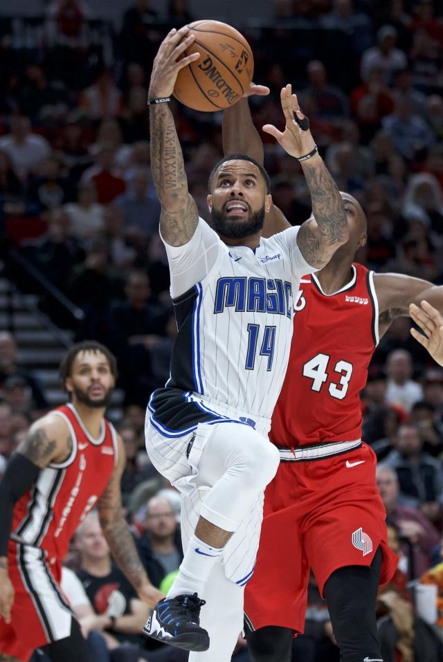 Orlando Magic guard D.J. Augustin (14) shoots in front of Portland Trail Blazers forward Anthony Tolliver during the second half of an NBA basketball game in Portland, Ore., Friday, Dec. 20, 2019. (AP Photo/Craig Mitchelldyer)