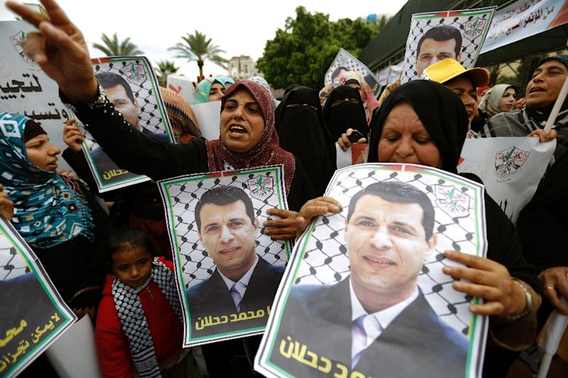 Palestinian supporters of dismissed senior Fatah leader Mohammed Dahlan shout slogans during a protest to support him on December 18, 2014, in Gaza City