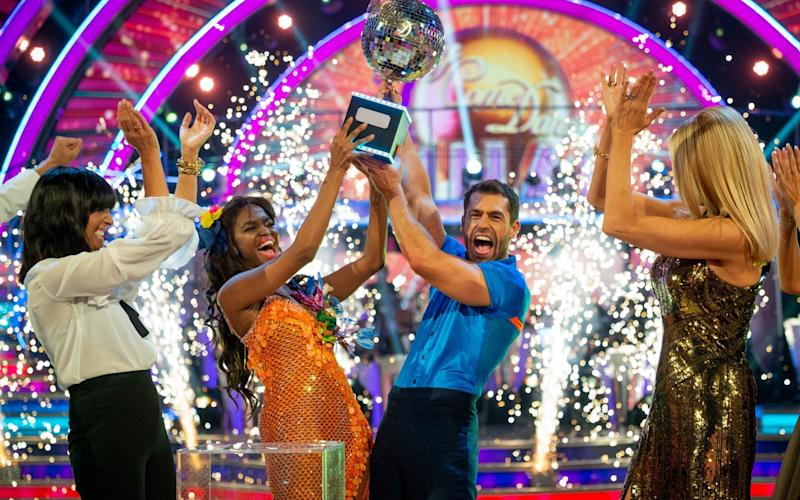 Kelvin and Oti lift the glitterball trophy - PA