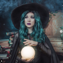 """<p>Slip on a black tank dress, then layer it with a sheer shirt and a sheer cape to create awesome texture. Make the look stand out with a wide-brimmed hat, a teal wig, and a crystal ball. </p><p><a class=""""link rapid-noclick-resp"""" href=""""https://www.amazon.com/BORIFLORS-Womens-Casual-Sleeveless-Bodycon/dp/B07K8NCGHY/?tag=syn-yahoo-20&ascsubtag=%5Bartid%7C10072.g.33534666%5Bsrc%7Cyahoo-us"""" rel=""""nofollow noopener"""" target=""""_blank"""" data-ylk=""""slk:SHOP BLACK DRESS"""">SHOP BLACK DRESS</a></p><p><a class=""""link rapid-noclick-resp"""" href=""""https://www.amazon.com/GRACE-KARIN-Elastic-T-Shirt-CL046-1/dp/B07Q4RXLTW?tag=syn-yahoo-20&ascsubtag=%5Bartid%7C10072.g.33534666%5Bsrc%7Cyahoo-us"""" rel=""""nofollow noopener"""" target=""""_blank"""" data-ylk=""""slk:SHOP SHIRT"""">SHOP SHIRT</a></p><p><a class=""""link rapid-noclick-resp"""" href=""""https://www.amazon.com/Black-Tattered-Length-Ghost-Standard/dp/B00KFX3VKS/?tag=syn-yahoo-20&ascsubtag=%5Bartid%7C10072.g.33534666%5Bsrc%7Cyahoo-us"""" rel=""""nofollow noopener"""" target=""""_blank"""" data-ylk=""""slk:SHOP CAPE"""">SHOP CAPE</a></p><p><a class=""""link rapid-noclick-resp"""" href=""""https://www.amazon.com/Woolen-Fedora-Vintage-Crushable-58-60cm/dp/B07RB4PWYY/?tag=syn-yahoo-20&ascsubtag=%5Bartid%7C10072.g.33534666%5Bsrc%7Cyahoo-us"""" rel=""""nofollow noopener"""" target=""""_blank"""" data-ylk=""""slk:SHOP HAT"""">SHOP HAT</a></p>"""