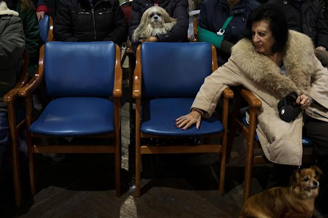 <p>People and their pets sit listen to a mass at San Anton Church in Madrid, Spain, Jan. 17, 2018. (Photo: Susana Vera/Reuters) </p>