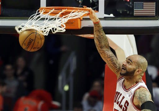 Chicago Bulls forward Carlos Boozer dunks against the Portland Trail Blazers during the first half of an NBA basketball game in Chicago on Thursday, March 21, 2013. (AP Photo/Nam Y. Huh)