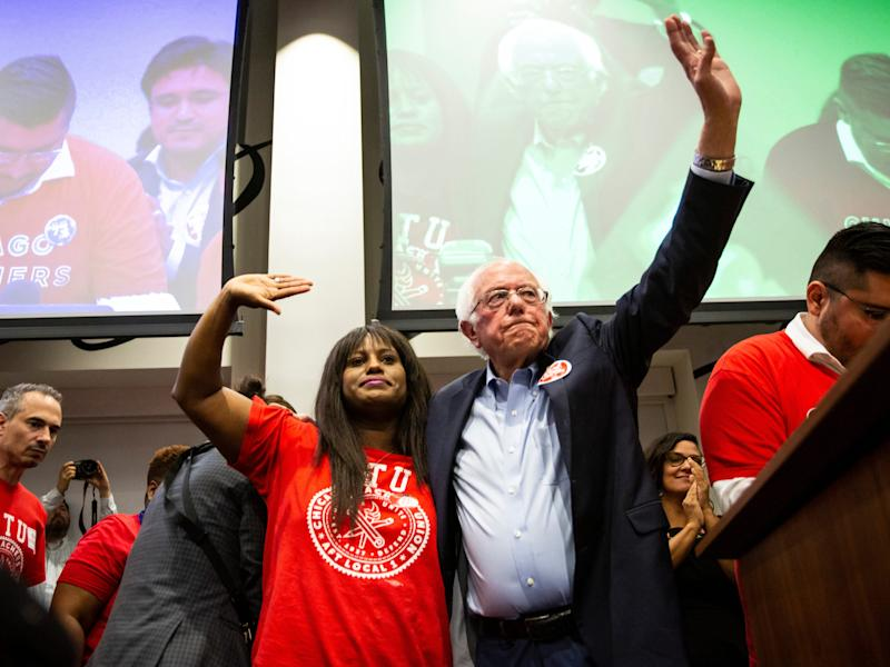 Presidential candidate U.S. Sen. Bernie Sanders, I-Vt., waves with Chicago Teachers Union Vice President Stacy Davis Gates after speaking at a rally at the Chicago Teachers Union headquarters, Tuesday, Sept. 24, 2019, in Chicago.