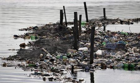 Rubbish covers the banks of Cunha channel, which flows into Guanabara Bay, in Rio de Janeiro