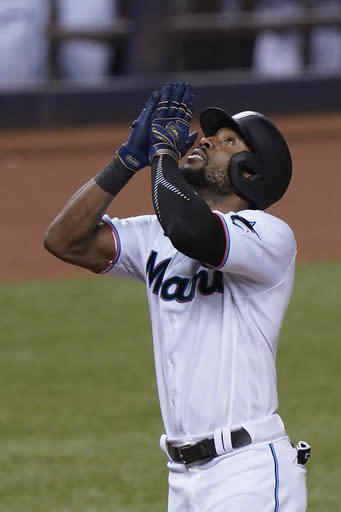Miami Marlins' Starling Marte celebrates as he reaches home plate after hitting a home run during the eighth inning of a baseball game against the Toronto Blue Jays, Tuesday, Sept. 1, 2020, in Miami. (AP Photo/Wilfredo Lee)