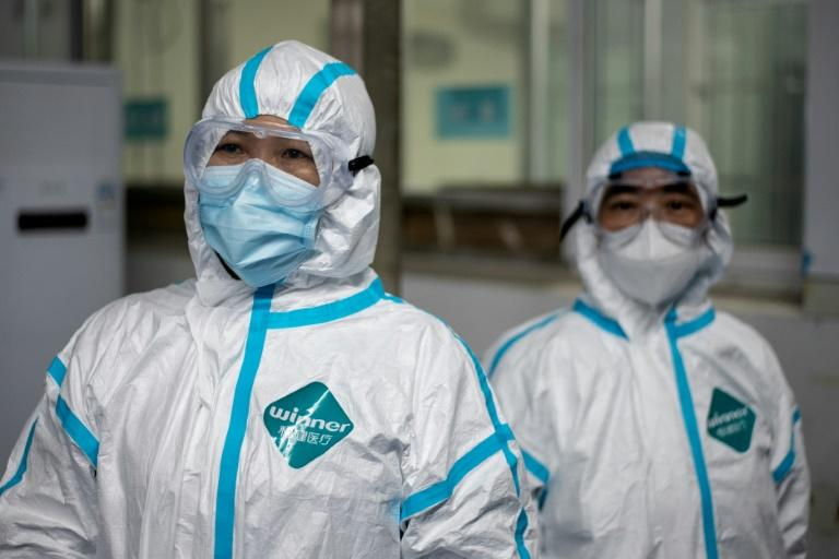 Medical workers wearing hazmat suits as prevention against the COVID-19 coronavirus at work at the Huanggang Zhongxin Hospital in Huanggang, in China's central Hubei province (AFP Photo/NOEL CELIS)