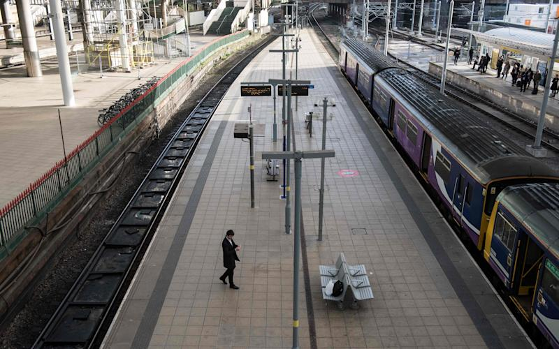First class carriages on busy trains should removed to ease overcrowding, the Department for Transport - Credit: AFP/Getty Images