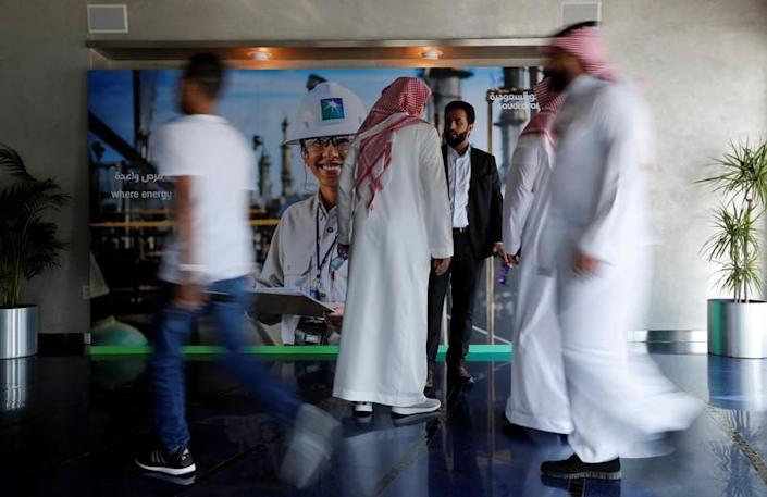 People are seen before the start of a press conference by Aramco at the Plaza Conference Center in Dhahran