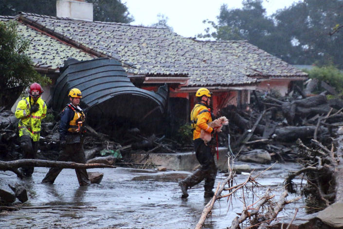 <p>A small dog is rescued on Olive Mill Rd. Tuesday, Jan. 9, 2018, in Montecito, Calif. (Photo: Stacey Wright/Santa Barbara Urban Hikers via AP) </p>