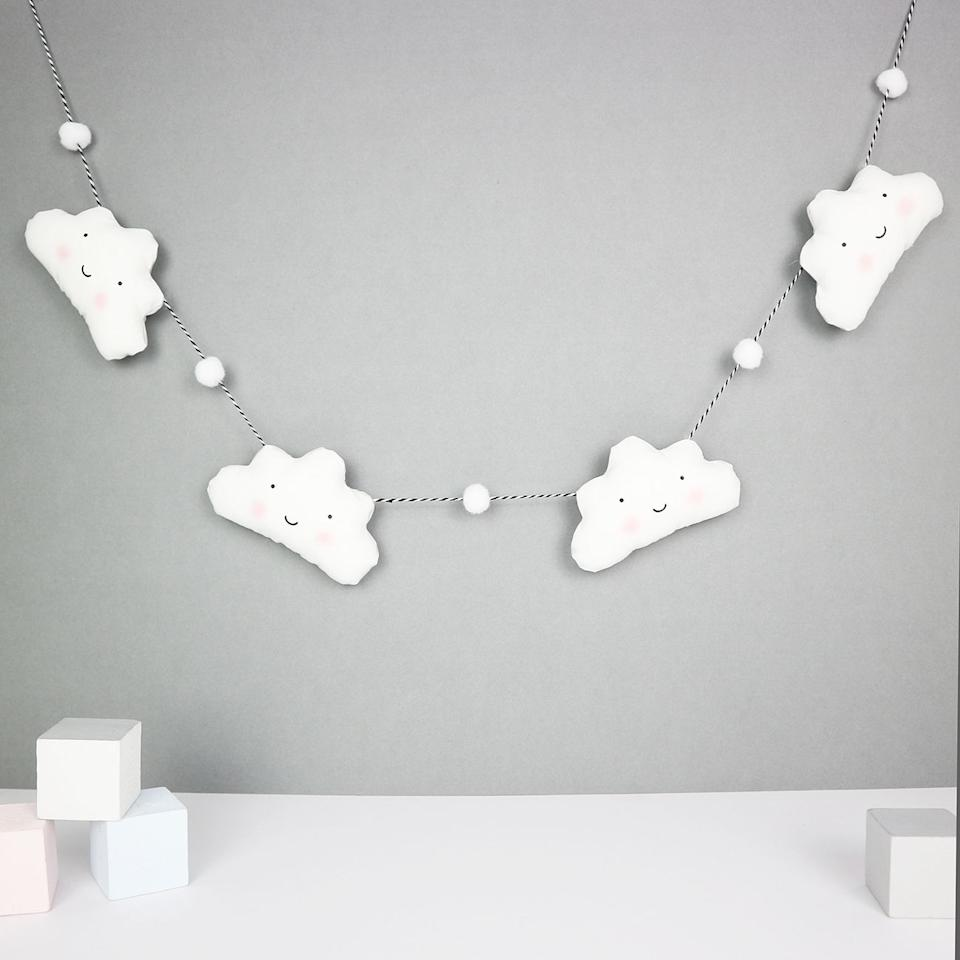 """<p>Cloud Garland With Mini Pom Poms by Paper and Wool, £24, Notonthehighstreet.com</p><p><a rel=""""nofollow"""" href=""""https://www.notonthehighstreet.com/paperandwool/product/cloud-garland-with-coloured-pom-poms"""">BUY NOW</a></p>"""