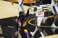 Phoenix Suns forward Jae Crowder (99) celebrates his three-point basket as Los Angeles Lakers guard Dennis Schroder (17) looks on during the first half of Game 1 of their NBA basketball first-round playoff series Sunday, May 23, 2021, in Phoenix. (AP Photo/Ross D. Franklin)