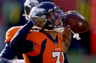 Denver Broncos free safety Justin Simmons (31) celebrates his interception against the Miami Dolphins during the first half of an NFL football game, Sunday, Nov. 22, 2020, in Denver. (AP Photo/David Zalubowski)