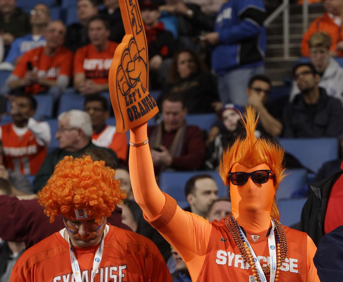 A Syracuse fan cheers before the team's third-round game against Dayton in the NCAA men's college basketball tournament in Buffalo, N.Y., Saturday, March 22, 2014. (AP Photo/Bill Wippert)