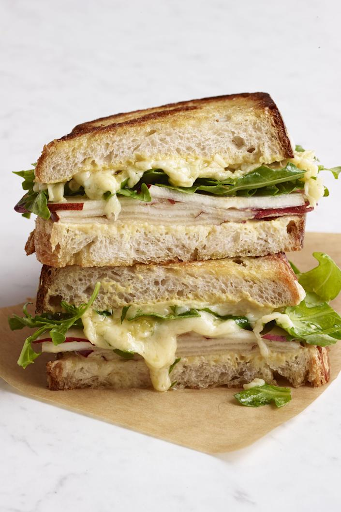 """<p>Even the most unskilled of cooks usually know how to make a <a href=""""https://www.womansday.com/food-recipes/food-drinks/recipes/a12182/basic-grilled-cheese-recipe-wdy1013/"""" rel=""""nofollow noopener"""" target=""""_blank"""" data-ylk=""""slk:basic grilled cheese"""" class=""""link rapid-noclick-resp"""">basic grilled cheese</a> decently well. It's a <a href=""""https://www.womansday.com/food-recipes/food-drinks/g3165/best-comfort-food-recipes/"""" rel=""""nofollow noopener"""" target=""""_blank"""" data-ylk=""""slk:classic comfort food"""" class=""""link rapid-noclick-resp"""">classic comfort food</a> recipe — one that's hard to dislike, easy to assemble, and costs almost nothing. Its simplicity is also why it's such an <a href=""""https://www.womansday.com/weeknight-dinners/"""" rel=""""nofollow noopener"""" target=""""_blank"""" data-ylk=""""slk:simple dinner recipe"""" class=""""link rapid-noclick-resp"""">simple dinner recipe</a> to kick up a notch. Simply add a few more ingredients here and there and you have endless ideas for gourmet grilled cheese sandwich recipes at your fingertips. </p><p>From adding in fruit (apples and cheese go well together for a reason!) to piling on the meats to swapping out traditional American slices for a more surprising combination of cheeses, there are endless possibilities when it comes to grilled cheese if you're willing to get a little creative. Once you have your favorite classic grilled cheese recipe down, try experimenting by adding some sautéed onions, slices of ham, a dab of mayo, or all of the above. Whether you tend to lean more savory (bacon grilled cheese, anyone?) or you want something on the sweeter side (s'mores grilled cheese, perhaps?), odds are there's a grilled cheese recipe out there for you that you haven't dreamed up quite yet. Looking for some inspiration? Here are some <a href=""""https://www.womansday.com/food-recipes/food-drinks/g3226/easy-dinner-recipes-for-kids/"""" rel=""""nofollow noopener"""" target=""""_blank"""" data-ylk=""""slk:easy recipes"""" class=""""link rapid-noclick-resp"""">easy recipes</a> to get"""
