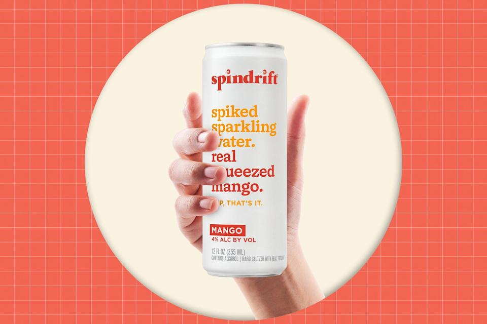 A hand holding a can of Spindrift Hard Seltzer on a designed background