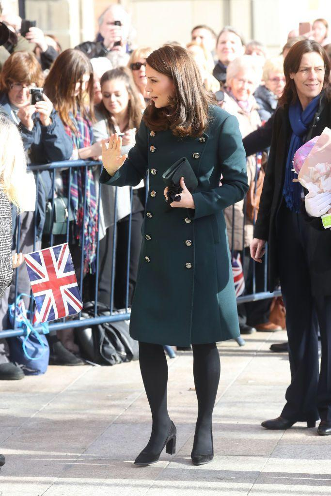 <p>Duchess Kate wore a green Dolce & Gabbana coat with black tights and Tod's pumps for a visit to Sunderland with Prince William. Under her chic coat, the Duchess wore a printed dress by Seraphine, one of her favorite maternity brands.</p>