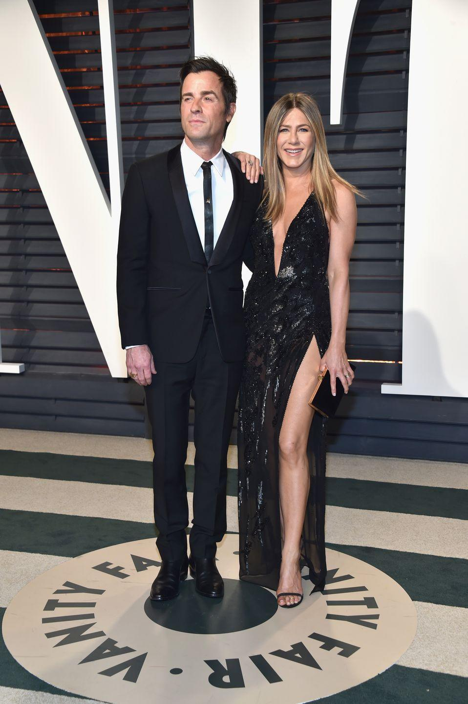 """<p>Jen looked absolutely phenomenal with now ex-husband Justin Theroux at the 2017 Vanity Fair Oscar Party. Her body seriously has not aged, and that might be due to her <a href=""""https://www.womenshealthmag.com/fitness/a26280079/jennifer-aniston-birthday-workout/"""" rel=""""nofollow noopener"""" target=""""_blank"""" data-ylk=""""slk:hardcore workouts"""" class=""""link rapid-noclick-resp"""">hardcore workouts</a>.<br></p>"""