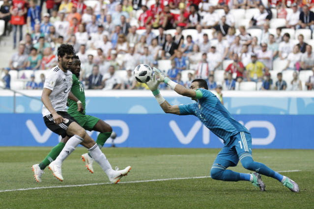 Egypt goalkeeper Essam El Hadary jumps for the ball during the group A match between Saudi Arabia and Egypt at the 2018 soccer World Cup at the Volgograd Arena in Volgograd, Russia, Monday, June 25, 2018. (AP Photo/Andrew Medichini)