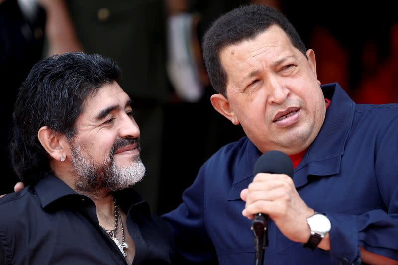 FILE PHOTO: Venezuela's President Hugo Chavez welcomes Argentina's soccer coach Diego Maradona at Miraflores Palace in Caracas