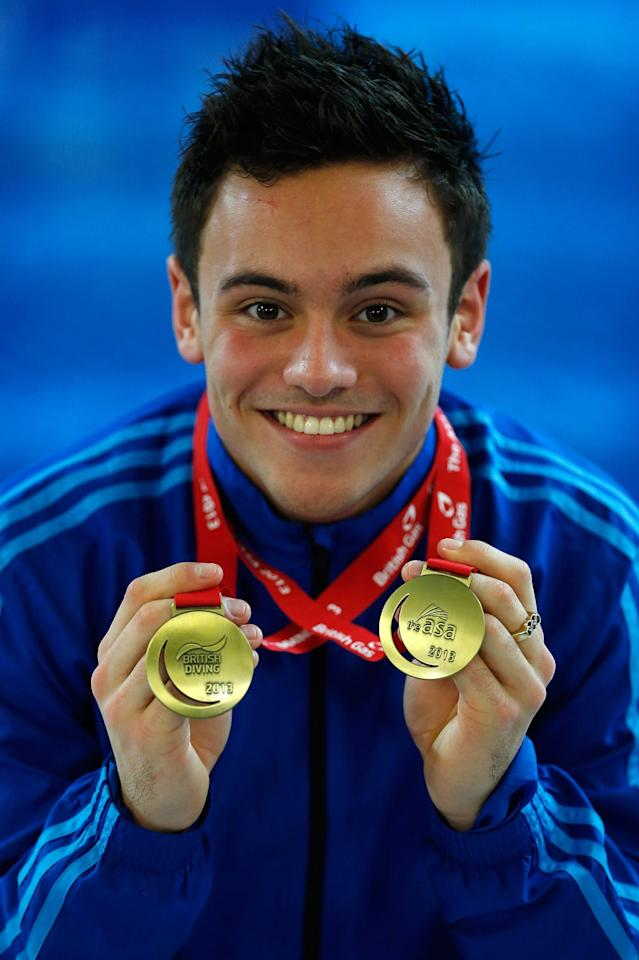 PLYMOUTH, ENGLAND - FEBRUARY 10: Tom Daley poses with his Gold medals after winning the Men's 10m final on day three of the British Gas Diving Championships on February 10, 2013 in Plymouth, England. (Photo by Harry Engels/Getty Images)