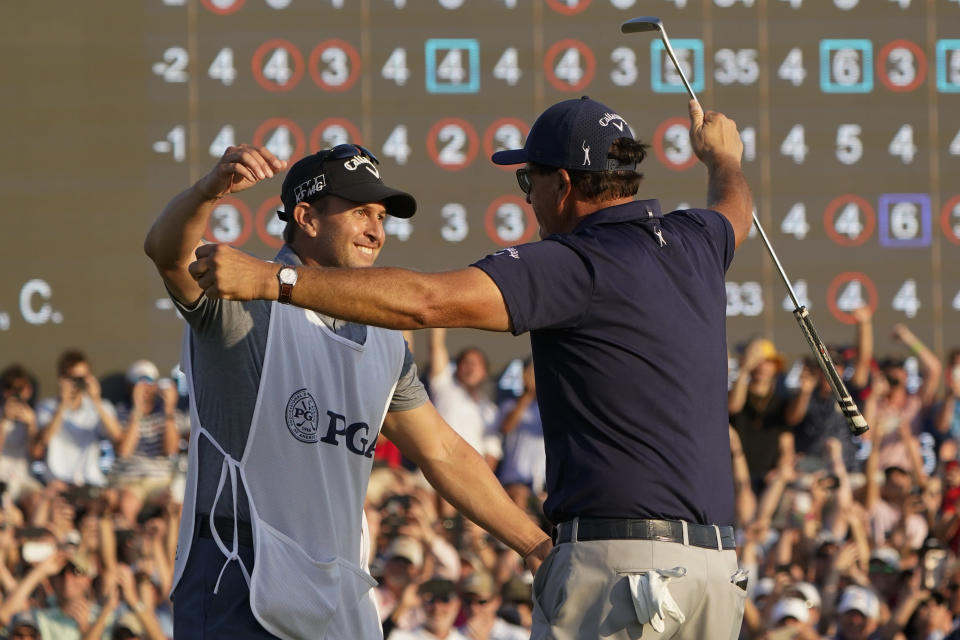 Phil Mickelson hugs his brother and caddie Tim after winning the final round at the PGA Championship golf tournament on the Ocean Course, Sunday, May 23, 2021, in Kiawah Island, S.C. (AP Photo/Chris Carlson)