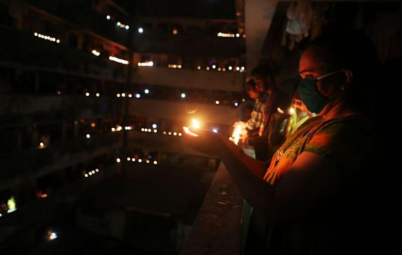 People light lamps to mark the country's fight against the Covid-19 pandemic in Mumbai. (Image: AP)