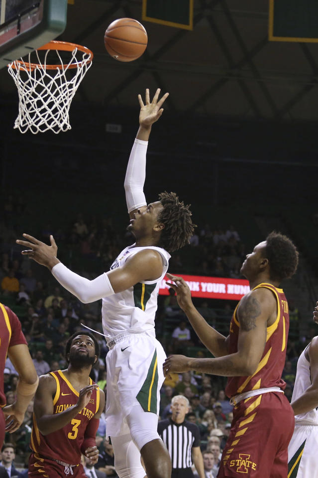 Baylor forward Freddie Gillespie (33) scores against Iowa State guard Tre Jackson (3) and forward Zion Griffin (0) during the second half half of an NCAA college basketball game Wednesday Jan. 15, 2020, in Waco, Texas. (AP Photo/Jerry Larson)