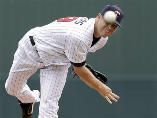 Minnesota Twins starting pitcher P.J. Walters delivers to the Toronto Blue Jays in the first inning of an exhibition spring training baseball game in Fort Myers, Fla., Sunday, March 24, 2013. (AP Photo/Elise Amendola)