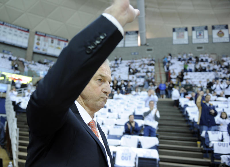 Connecticut coach Jim Calhoun acknowledges the crowd as he enters before his team's basketball game with Pittsburgh in Storrs, Conn., on Saturday, March 3, 2012. Calhoun missed the Huskies last eight games and had back surgery last Monday.(AP Photo/Fred Beckham)