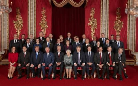 Leaders of Nato member states and its secretary general join the Queen and the Prince of Wales for a group picture - Credit: Yui Mok /PA