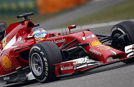 Ferrari Formula One driver Alonso of Spain drives during the Chinese F1 Grand Prix at the Shanghai International circuit