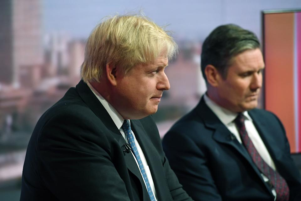 Foreign Secretary Boris Johnson (left) and Shadow Brexit Secretary Sir Keir Starmer during filming for the BBC One current affairs programme The Andrew Marr Show at New Broadcasting House in London.