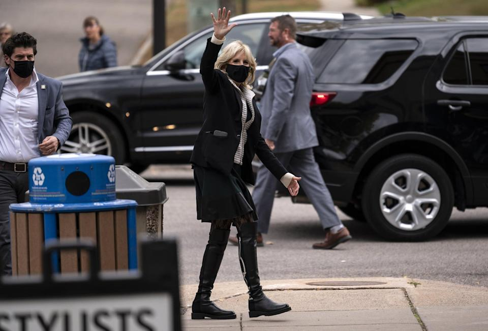 <p>Jill wore her Vote boots throughout the campaign trail. She coordinated them with lace tights and a knee-length skirt while in St. Paul, MN, in early October 2020.</p>