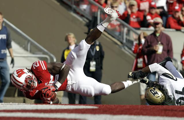 Wisconsin's Melvin Gordon (25) breaks away from Purdue's Antoine Lewis for a touchdown run during the first half of an NCAA college football game Saturday, Sept. 21, 2013, in Madison, Wis. (AP Photo/Morry Gash)