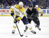 Nashville Predators defenseman Mattias Ekholm (14) controls the puck in front of Tampa Bay Lightning center Brayden Point (21) during the first period of an NHL hockey game Saturday, Oct. 26, 2019, in Tampa, Fla. (AP Photo/Chris O'Meara)