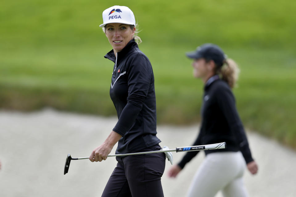 Mel Reid, of England, walks off the course after finishing the first round of the U.S. Women's Open golf tournament at The Olympic Club, Thursday, June 3, 2021, in San Francisco. (AP Photo/Jed Jacobsohn)